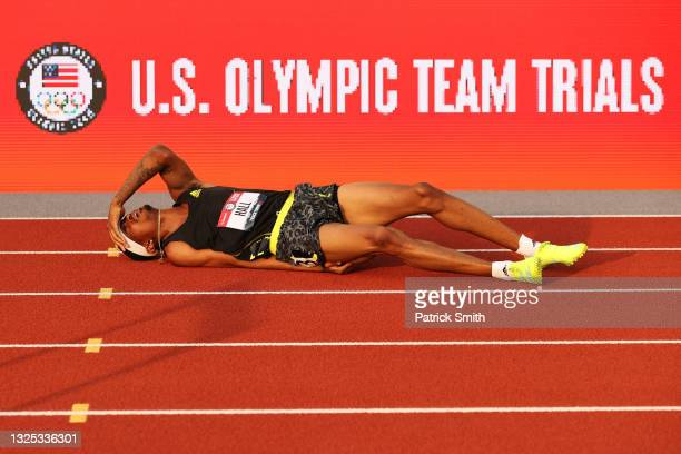 Quincy Hall lies on the track after a fall in the first round of the Men's 400 Meter Hurdles on day seven of the 2020 U.S. Olympic Track & Field Team...