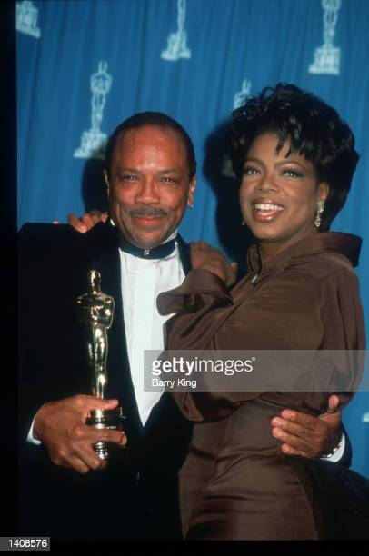 Quincy Jones and Oprah Winfrey attend the 67th Annual Academy Awards ceremony March 27 1995 in Los Angeles CA This year''s ceremony recognizes...