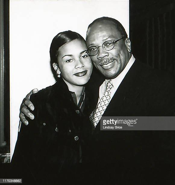 Quincy Jones hugs his daughter Kidada Jones as they arrive at the ACLU Bill of Rights Dinner at the Beverly Wilshire Hotel on December 16 1996 in...