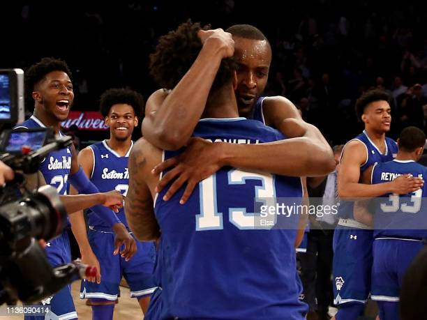 Quincy McKnight of the Seton Hall Pirates celebrates the win with teammate Myles Powell after the game against the Marquette Golden Eagles during the...