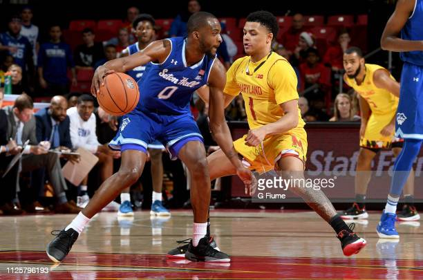 Quincy McKnight of the Seton Hall Pirates handles the ball against Anthony Cowan Jr #1 of the Maryland Terrapins at Xfinity Center on December 22...