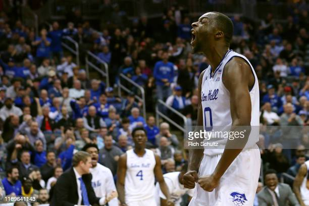 Quincy McKnight of the Seton Hall Pirates reacts after scoring during the second half of a college basketball game at Prudential Center on December...