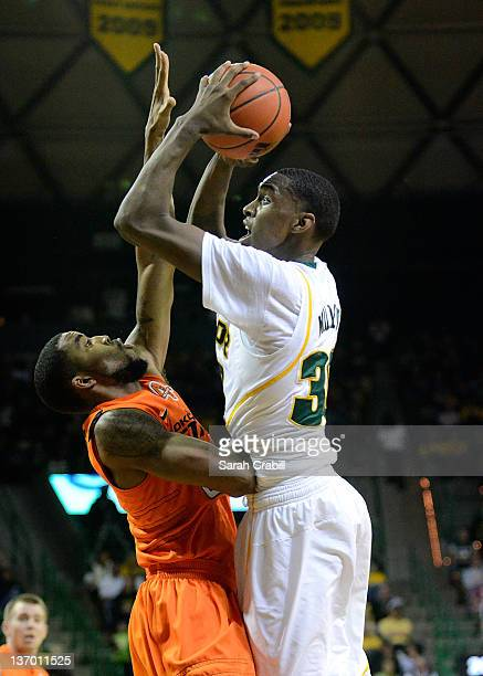 Quincy Miller of the Baylor Bears shoots during a game against the Oklahoma State Cowboys at Ferrell Center on January 14 2012 in Waco Texas The...