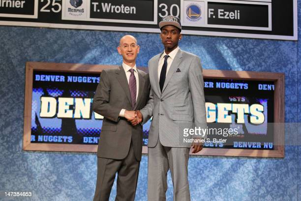 Quincy Miller shakes hands with NBA Deputy Commissioner Adam Silver after being selected number thirtyeighth overall by the Denver Nuggets during the...