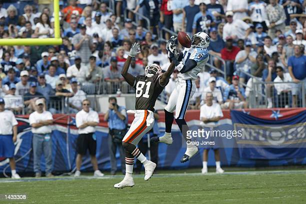 Quincy Morgan of the Cleveland Browns has a pass almost intercepted by Samari Rolle of the Tennessee Titans during the NFL game on September 22 2002...