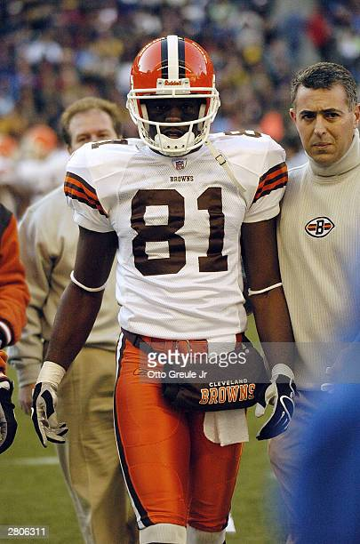 Quincy Morgan of the Cleveland Browns is walked off the field during the game against the Seattle Seahawks on November 30 2003 at Seahawks Stadium in...