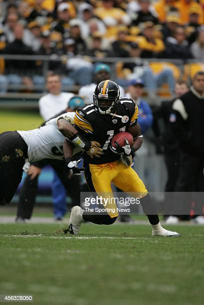 Quincy Morgan of the Pittsburgh Steelers runs through the tackle during a game against the Quincy Morgan on October 16 2005 at Heinz Field in...