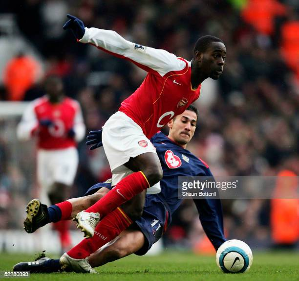 Quincy OswusuAbeyie of Arsenal moves past Giannis Skopelitis of Portsmouth during the Barclays Premiership match between Arsenal and Portsmouth at...