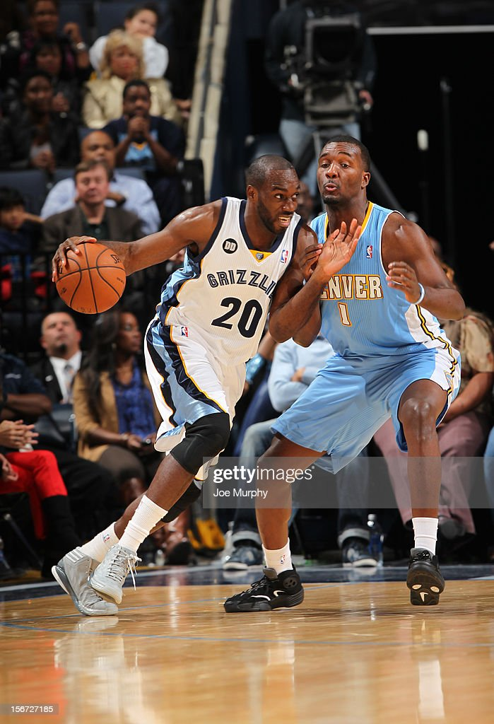 Quincy Pondexter #20 of the Memphis Grizzlies drives against Jordan Hamilton #1 of the Denver Nuggets on November 19, 2012 at FedExForum in Memphis, Tennessee.