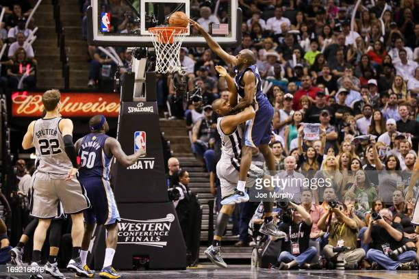 Quincy Pondexter of the Memphis Grizzlies dunks late in the fourth quarter against Boris Diaw of the San Antonio Spurs in Game Two of the Western...