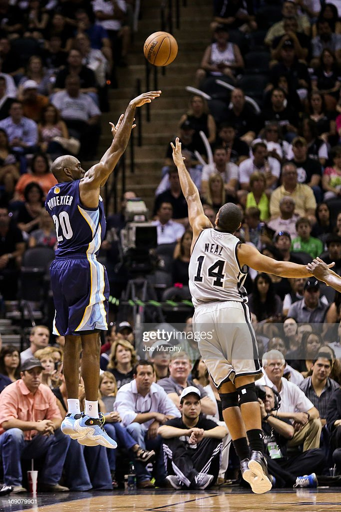 Quincy Pondexter #20 of the Memphis Grizzlies shoots a three-pointer against Gary Neal #14 of the San Antonio Spurs in Game One of the Western Conference Finals during the 2013 NBA Playoffs on May 19, 2013 at the AT&T Center in San Antonio, Texas.