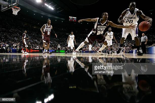 Quincy Pondexter of the Washington Huskies moves the ball as Phil Turner of the Mississippi State Bulldogs goes after it during the first round of...