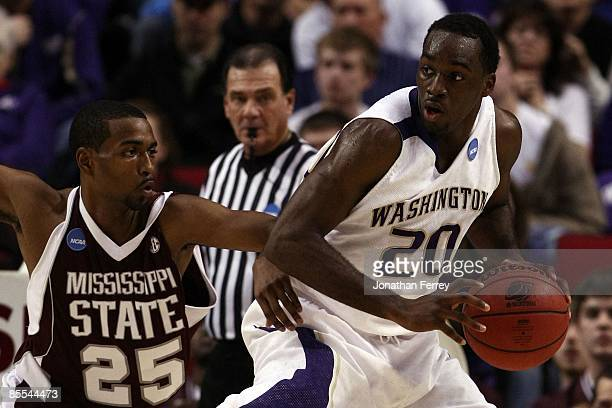 Quincy Pondexter of the Washington Huskies posts up Phil Turner of the Mississippi State Bulldogs during the first round of the NCAA Division I Men's...