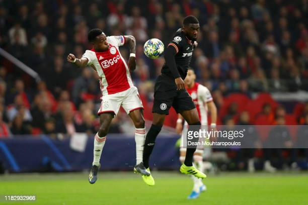 Quincy Promes of AFC Ajax battles for possession with Fikayo Tomori of Chelsea during the UEFA Champions League group H match between AFC Ajax and...