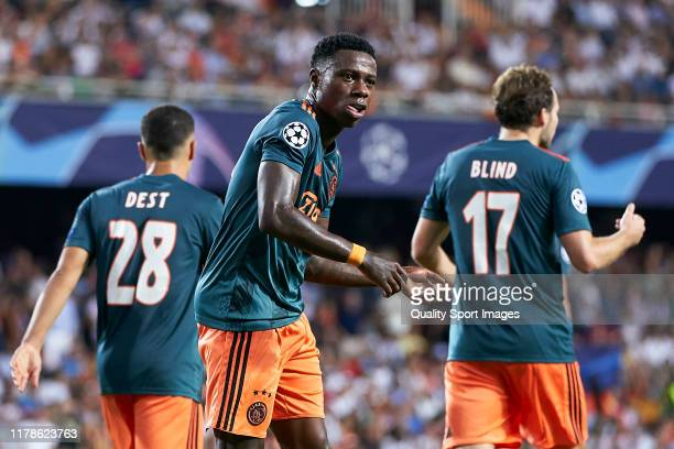 Quincy Promes of AFC Ajax celebrates after scoring his team's second goal during the UEFA Champions League group H match between Valencia CF and AFC...