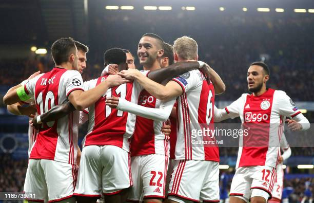 Quincy Promes of AFC Ajax celebrates with teammates after scoring his team's first goal during the UEFA Champions League group H match between...