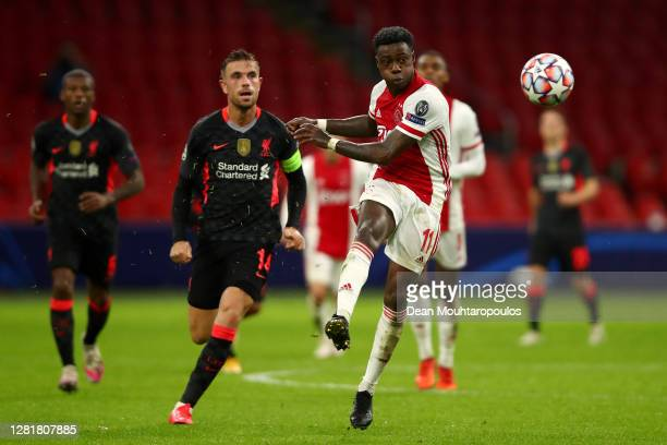 Quincy Promes of Ajax battles for the ball with Jordan Henderson of Liverpool during the UEFA Champions League Group D stage match between Ajax...