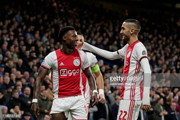 Quincy Promes of Ajax Celebrates 01 with Hakim Ziyech of Ajax during the UEFA Champions League match between Chelsea v Ajax at the Stamford Bridge on...