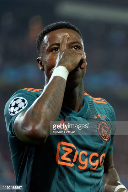 Quincy Promes of Ajax celebrates after scoring the second goal of his team during the UEFA Champions League group H match between Lille OSC and AFC...
