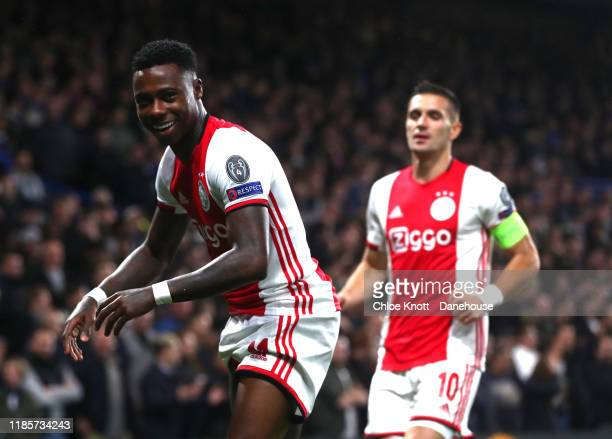 Quincy Promes of Ajax celebrates scoring his teams first goal during the UEFA Champions League group H match between Chelsea FC and AFC Ajax at...