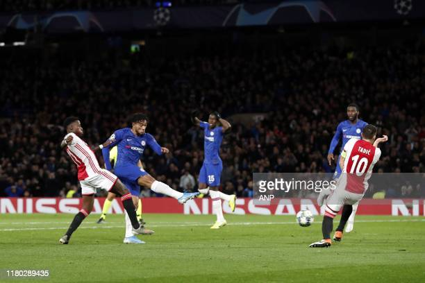 Quincy Promes of Ajax Reece James of Chelsea FC Dusan Tadic of Ajax during the UEFA Champions League group H match between Chelsea FC and Ajax...