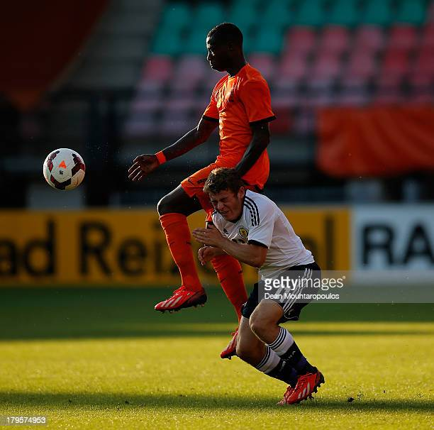 Quincy Promes of Netherlands fouls Ryan Fraser of Scotland during the 2015 UEFA European U21 Championships Qualifier between Netherlands U21s and...