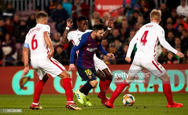 Quincy Promes of Sevilla commits penalty over Lionel Messi of FC Barcelona during the Copa del Rey second leg Quarter Final match between FC...