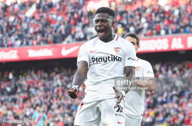 Quincy Promes of Sevilla FC celebrates scoring his team's opening goal with team mates during the La Liga match between Sevilla FC and Rayo Vallecano...