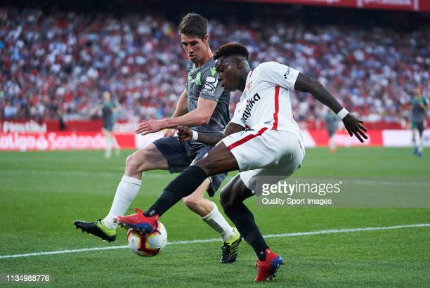 Quincy Promes of Sevilla FC competes for the ball with Aritz Elustondo of Real Sociedad during the La Liga match between Sevilla FC and Real Sociedad...