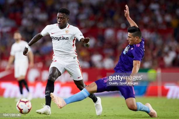 Quincy Promes of Sevilla FC competes for the ball with Facundo Roncaglia of RC Celta de Vigo during the La Liga match between Sevilla FC and RC Celta...