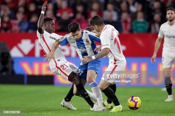 Quincy Promes of Sevilla FC Marc Roca of Espanyol Ever Banega of Sevilla FC during the La Liga Santander match between Sevilla v Espanyol at the...
