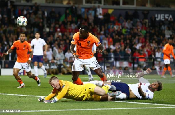Quincy Promes of the Netherlands beats Jordan Pickford and Kyle Walker of England as he scores his team's second goal during the UEFA Nations League...