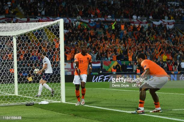 Quincy Promes of the Netherlands celebrates after scoring his sides third goal with Memphis Depay of the Netherlands during the UEFA Nations League...