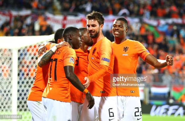 Quincy Promes of the Netherlands celebrates after scoring his team's third goal with Davy Propper and Denzel Dumfries and team mates during the UEFA...
