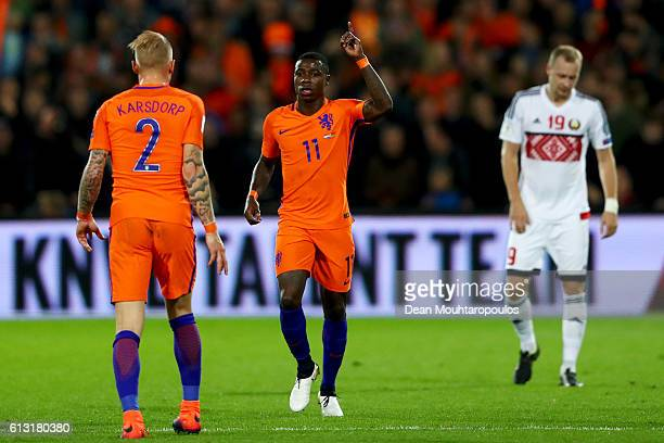 Quincy Promes of the Netherlands celebrates scoring his teams second goal of the game with team mates during the FIFA 2018 World Cup Qualifier...