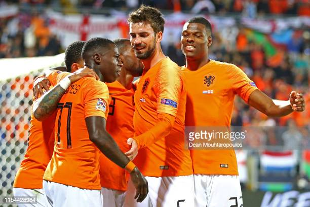 Quincy Promes of The Netherlands celebrates scoring his teams third goal of the game with team mates Davy Propper Denzel Dumfries Memphis Depay and...