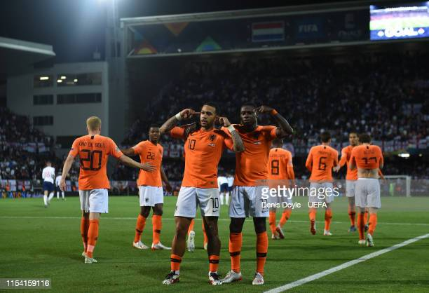 Quincy Promes of the Netherlands celebrates with Memphis Depay of the Netherlands after scoring his sides third goal during the UEFA Nations League...