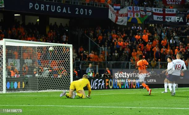 Quincy Promes of the Netherlands scores his team's third goal as Jordan Pickford of England looks on during the UEFA Nations League SemiFinal match...