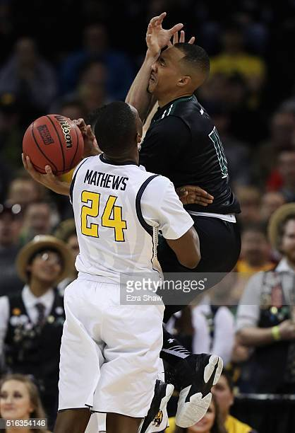 Quincy Smith of the Hawaii Warriors is fouled by Sam Singer of the California Golden Bears as Jordan Mathews looks on in the first half during the...
