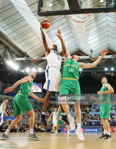 Quincy Spencer Davis III of Chinese Taipei shoots past Matt Hodgson of the Boomers during the FIBA World Cup Qualifying match between the Australian...