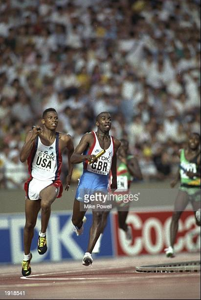 Quincy Watts of the USA and Derek Redmond of Great Britain in action in the 4 x 400 Metres Relay event during the 1991 World Championships in Tokyo...