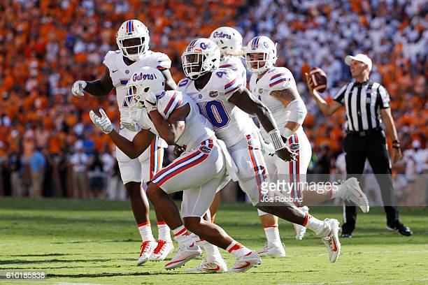 Quincy Wilson of the Florida Gators celebrates with Jarrad Davis after an interception against the Tennessee Volunteers in the second quarter at...