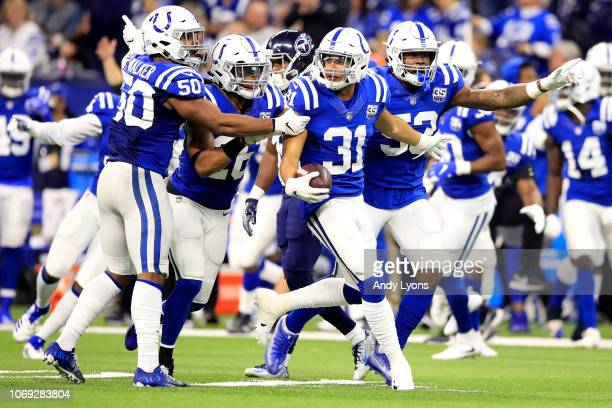 Quincy Wilson of the Indianapolis Colts celebrates with his team after catching an interception in the game against the Tennessee Titans in the...