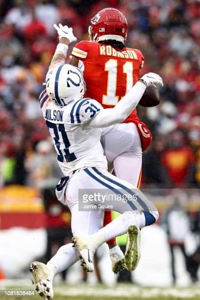 Quincy Wilson of the Indianapolis Colts defends a pass from Demarcus Robinson of the Kansas City Chiefs during the first quarter of the AFC...