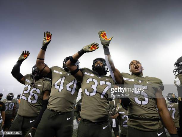 Quindrelin Hammonds, Nathaniel Smith, Hamilton Baker, and A.J. Howard of the Army Black Knights wave to the crowd during the fourth quarter of a game...
