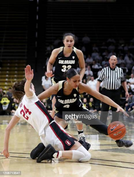 Quinessa CaylaoDo of the Colorado Buffaloes fouls Lacie Hull of the Stanford Cardinal in an attempt to regain possession during the fourth quarter of...