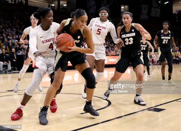 Quinessa CaylaoDo secures the rebound of a missed free throw from Mya Hollingshed of the Colorado Buffaloes during the fourth quarter of a game...