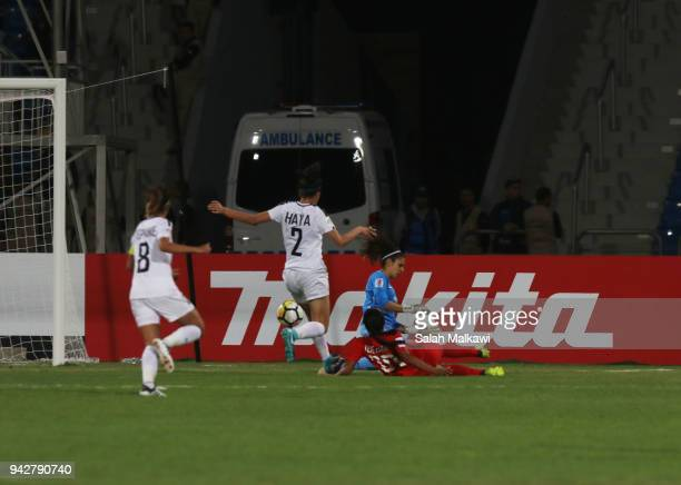 Quinley QUEZADA of Philippines competes with Jordan's goalkeeper Sherin AL SHALABE and Haya KHALIL during their match for the AFC Womenâs Asian Cup...