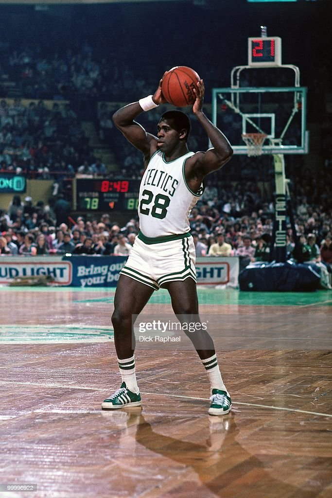 Quinn Buckner #28 of the Boston Celtics passes during a game played in 1983 at the Boston Garden in Boston, Massachusetts.