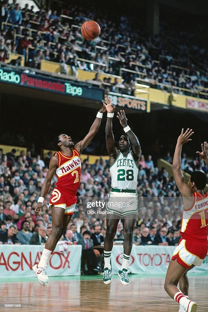 Quinn Buckner #28 of the Boston Celtics shoots a jump shot over Rory Sparrow #2 of the Atlanta Hawks during a game played in 1983 at the Boston Garden in Boston, Massachusetts.